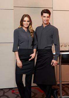 Polyester, Cotton Twill Below knee, Bistro length Unique styling No front pocket Longer length waist ties Free size x 190 GSM Available in Black only Cafe Uniform, Waiter Uniform, Hotel Uniform, Office Uniform, Uniform Ideas, Corporate Uniforms, Staff Uniforms, Corporate Wear, Work Uniforms