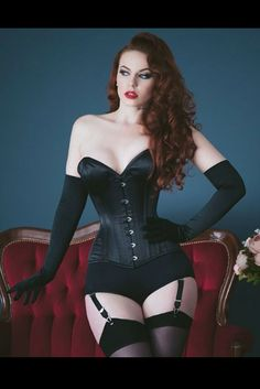 Drop dead gorgeous corsetry? You've come to the right place. Sometimes deliciously dark lingerie is the only way to go; wrap your waist in one of our corsets, wiggle into sleek satin gloves and step into your highest heels for indomitable boudoir glamour. Emmerald Barwise wears our iconic Laurie Corset, Liz Suspender Knickers, Glamour Seamed Stocking and Long Sheer Gloves for this gorgeous shoot by Tigz Rice with MUAH by Ewa Baberska