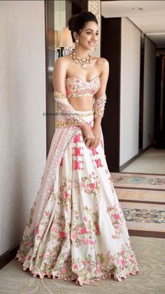 Kiara Advani looks like a complete charmer in this ivory riveted floral lehenga with metal sequins & bangle embroidery. Call/WhatsApp for Purchase Inqury :