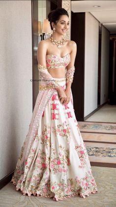 Kiara Advani looks like a complete charmer in this ivory riveted floral lehenga with metal sequins & bangle embroidery. Call/WhatsApp for Purchase Inqury : Indian Lehenga, Pakistani Bridal Lehenga, Red Lehenga, Lehenga Choli Wedding, Designer Bridal Lehenga, Pakistani Suits, Sabyasachi, Pakistani Dresses, Indian Wedding Outfits
