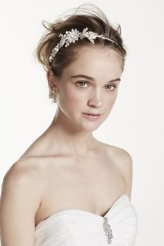 Feel like a princess every day in a delicate headbandwith an array of silver flowers and creamy pearls.   Silver flowers and creamy pearls are displayed on the side for that extra flare!  Available in Crystal/Silver.  Imported.
