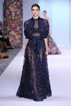 Midnight blue tulle skirt and bomber jacket appliquéd with taffeta cut-out flowers, accompanied by a silk organza cross hatch ribbon body, embroidered with metallic glass beads.
