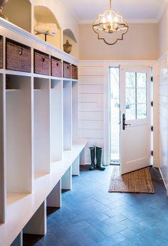 Organized entry with shiplap and herringbone floors