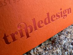 Red hot foil deboss logo in a business card. Project developed at Triple Atelier. #logodesign #lettering #identity #ligature #businesscards #orange #red #tripledesign