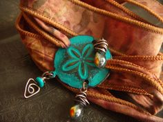 Fabric and Sand Dollar Beaded Wrist Wrap. $39.00, via Etsy.