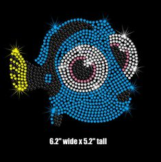 This baby Dory iron on rhinestone transfer is created with hundreds of sparkly black, citrine, capri blue, pink and crystal clear rhinestones. The design is 6.2 wide x 5.2 tall. It is shown on a childs shirt for scale (shirt not included). The iron on transfer is easy to apply with a