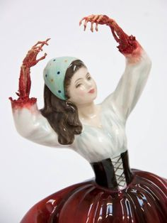 Gory porcelain doll figures by Jessica Harrison
