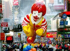 The Ronald McDonald balloon makes his way through Times Square during the 76th annual Macys Thanksgiving Day Parade in 2002.  There were 13 giant character balloons that year.