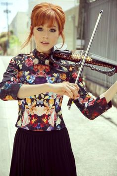 Lindsey Stirling: I love her fun nerdy personality and that she is a hardworker, I am so flippin excited about going to her concert this month!! :D #ElectricViolin