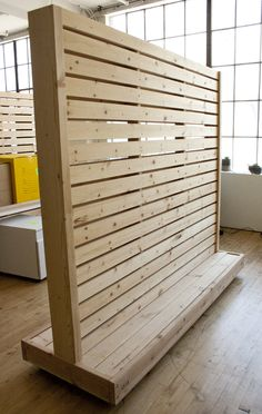 This wall partition is a fun and useful way to separate space in offices with an open layout heavy duty locking casters allow the structure to be moved and set in place with ease the piece is mad… Pallet Walls, Pallet Furniture, Custom Furniture, Wood Walls, Furniture Layout, Wood Paneling, Office Furniture, Murs Mobiles, Movable Walls