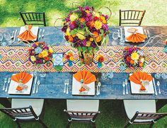 Cinco de Mayo wedding inspiration // bright colors, maracas on napkins, patterned table runner