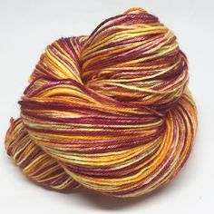 This sock yarn is absolutely spectacular.It's perfect for socks, as BFL is a soft but hard-wearing fibre, and silk will add more strength and comfort. It's also great for shawls and scarves, because it's beautifully drapey. It will look exquisite and feel luxuriously soft around your neck. Heaven.The colour is a wild mix of pale yellow, fiery orange and rich plum, like magma and lava exploding from an active volcano. This yarn is perfect for the adventurous explorer, who laughs in the face…