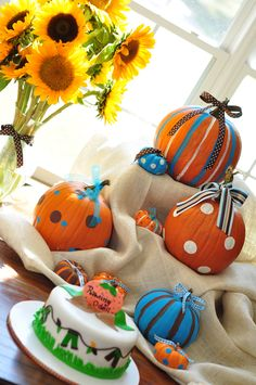 CUTE FOR A FALL BABY :)  We'd have to do gender neutral fall colors instead of blue, but I like the addition of color
