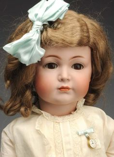 "At Auction: April 27th. Remarkable K & R 117 Character Doll. Original white cotton dress with lace trim, undies, shoes and socks; in original box labeled ""Made in Germany K [star] R Royal Doll"". Fabulous look to this one! #K #Dolls #MorphyAuctions"