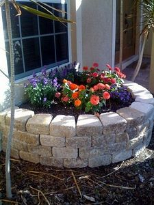 The stone paver retaining wall I built makes a perfect raised flower bed! - Flower Beds and Gardens Stone Flower Beds, Raised Flower Beds, Brick Flower Bed, Flower Bed Borders, Raised Bed, Small Flowers, Pretty Flowers, Diy Flowers, Outdoor Projects