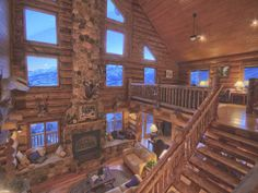 This stunning log home offers exquisite mountain views from a picturesque, elevated setting. Enjoy the impressive Mt. Timpanagos peaks and the purple sunset glow of the Uintas from nearly every room. With a towering 44' ceiling, this mountain lodge manages to be both inspiring and cozy. A large wrap-around deck expands into an outdoor living room, hot tub ready, complete with a porch swing, picnic tables, and a gas grill.