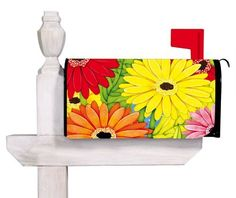 """Evergreen Bright Gerber Daisies,Magnetic Mailbox Cover,18x24 Inches by Ashley. $12.99. All-weather and fade resistant. Clings to your mailbox in a snap and fits all standard sized mailboxes. Coated PVC design is backed with full surfact magnet. Fits all standard size mailboxes,the size is: 18""""x24""""; For plastic mailbox, please pick our """"Evergreen Magnetic Mailbox Cover Adapter Kit,17x1.5 Inches"""" or check """"ASIN: B006XF571I"""" in order to use it.. Original Artwork by © J..."""