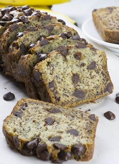 One piece of bread in front of loaf of Chocolate Chip Banana Bread