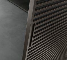 brown aluminium structure and grey transparent glass