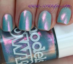 """Models Own """"Indian Ocean"""" over unidentified baby blue creme polish"""