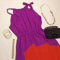 "HP 12/21 T.L.H by Hype colorblock dress T.L.H by Hype purple/bright orange-red colorblock dress, size XS, overall length 36"", purple inner lining, 100% polyester, dry clean only. Left should tie, elastic waistband. No zippers or pockets. Worn once so it's in excellent condition. No damage/fraying/stains. Has been cleaned and stored in a non-smoking home. Necklace, bracelets, purse not included. No trades or PP. HP 12/21 *15% off bundles of 2+ items!* Hype Dresses"