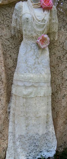 Lace wedding dress handmade by vintage opulence on Etsy The top is a soft cream knit fabric with tassel fringe over the bust and at the cap