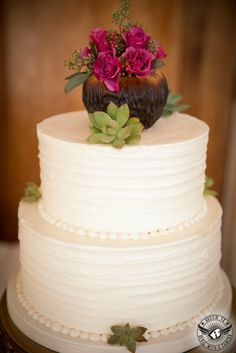 buttercream ruffles wedding cake with floral topper from French Inspired Floral, LLC.
