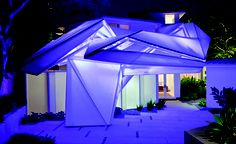 """""""Designed by B+U, this exterior canopy addition to a residence in Pasadena, CA is comprised of a steel frame and resin coated fiberglass sheets."""""""