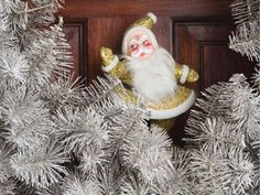 USE SPRAY PAINT TO DECORATE:  Plain dry branches from your yard—whether from green firs or bare deciduous trees—make excellent decorations when you spray with silver or gold paint. Hang, or tuck in a vase to decorate an entryway or dining room. Plus, add ornaments to the branches for an instant Christmas tree.