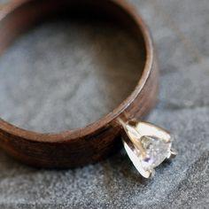 Wooden Moissanite Ring - Ebony with 4mm Moissanite in 14k Yellow Gold. $375.00, via Etsy.