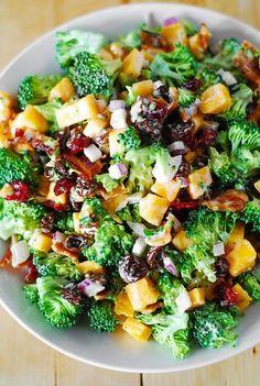 Pea salad w broccoli & cheddar. no raisins or crasins stuff. Broccoli salad with bacon, raisins, and cheddar cheese: comfort food and it's gluten free! Broccoli Salad Bacon, Bacon Salad, Broccoli Cheddar, Cheese Salad, Low Carb Brocolli Salad, Broccoli Salad With Raisins, Fresh Broccoli, Broccoli Recipes, Healthy Salads