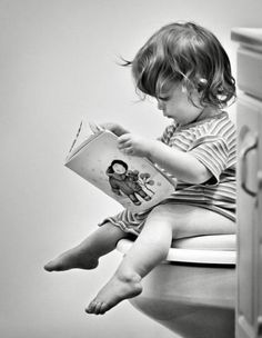 Baby reading in toilet. By Your Guide