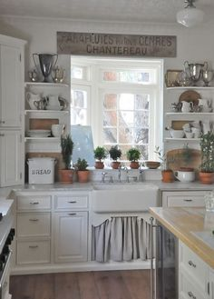 Love the wood floors with the white cabinets and light (almost white) countertops.  Cute open shelving too.