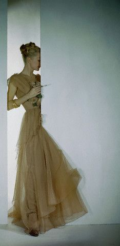 Photo: Constantin Joffe, 1946. 40s pink beige cream yellow evening gown long tulle net formal color photo print ad vintage fashion style