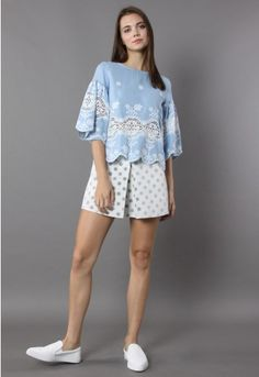 Nothing shows off your inner gril better than this adorable smock top! Atop the mild blue base adorn a white flower embroidery and a lace cutout panel. With the scrolled cuffs and hem adding extra cuteness, this one is meant to make happy memories!  - Scooped neckline - Keyhold cutout with button to reverse - Relaxed fit - 100% Cotton - Hand wash cold  Size(cm) Length Bust Shoulder Sleeves S/M      54    104    38      44 L/XL     54    108    42  ...