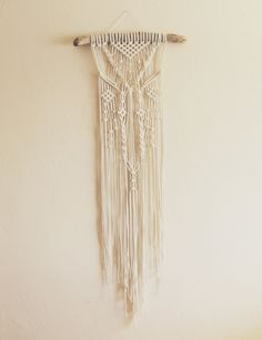 Braided Macrame Wall Hanging on Driftwood by macrameforest on Etsy https://www.etsy.com/listing/226627695/braided-macrame-wall-hanging-on