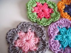 flower motif - would totally use this for a granny square blanket for (someone's) baby girl