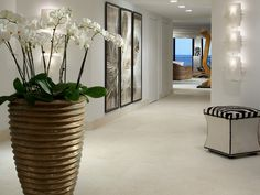 See this all-white contemporary foyer with potted orchids and bold artwork only on HGTV. Decor, Store Decor, Farmhouse Kitchen Decor, Entry Way Design, Cheap Home Decor, Home Decor, Family Room Makeover, Elegant Interiors, Fireplace Makeover