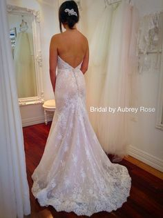 Stunning gown. Look at that lace detail!!