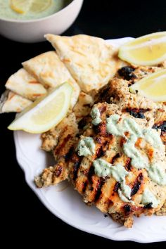 Grilled Greek Chicken with Feta Tzatziki Sauce: Greek food is my life. The feta tzatziki sauce would be yummy on everything/anything!