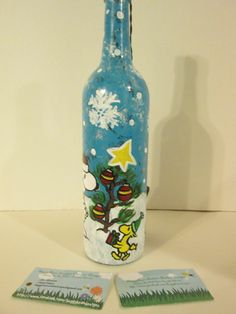 """Peanuts"" themed lighted wine bottle with Snoopy, Woodstock and Charlie Brown and his little tree! View #2 https://www.facebook.com/buggybeandesigns"