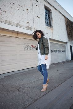 Vintage flight jacket, Joseph shirtdress, Madewell jeans, and Jimmy Choo pumps.