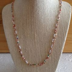 """Multi Colored BeadsHandmade copper wire linksRose Gold Chain23"""" all the way around This necklace was partially made by the women in India and refined here in the U.S.!Happy Valentine's Day!"""