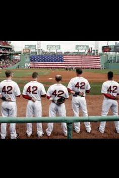 262fe1974 Boston Red Sox players line up for the National Anthem all wearing number  42 in honor of Jackie Robinson Day before a baseball game between the Red  Sox and ...