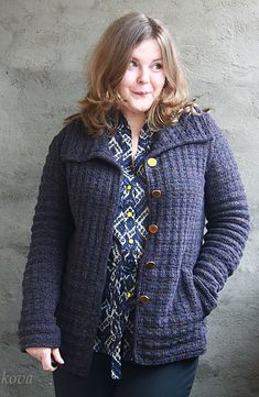 Men's wear inspired but softer and lighter, with a nicely feminine fit. The allover texture stitch, reminiscent of the subtle plaids used in classic woolen 'sporting' jackets, is a simple knit/purl combination, easily memorized and quickly knit in a worsted weight yarn. The jacket features generously sized welt pockets and an oversized collar knitted up from the scooped neck. The body and pockets are worked in one piece to the underarms, then fronts and back are divided and worked separa...