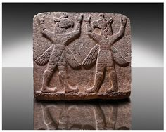"""Picture of Neo-Hittite orthostat describing the legend of Gilgamesh from Karkamis - Turkey.  Symetrical mythological Scene depicting """"Winged Griffin Demons"""", half men with birds heads & wings. Their hands are raised above their heads supposidly carrying the sky. 