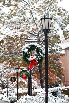 These snowy street lamps almost take you back in time. The hanging wreaths also add a very festive touch.