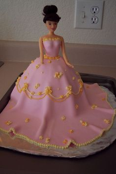 Barbie cake - This was my first doll cake, first ust of fondant (we used a recipe from cc and it turned out fabulous!), and first try at making drop flowers with royal icing.  She turned out great if I do say so myself!! :-)  She's for my niece's 3rd birthday.