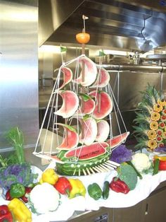 watermelon ship--- check out FB Healthy Eating with Michelle Holloman! She has fantastic ideas!Another creation from the chef--watermelon too beautiful to eat!Love this as a centre piece Watermelon Boat, Watermelon Carving, Fruit Sculptures, Food Sculpture, Veggie Art, Fruit And Vegetable Carving, Fruits Decoration, Deco Fruit, Amazing Food Art