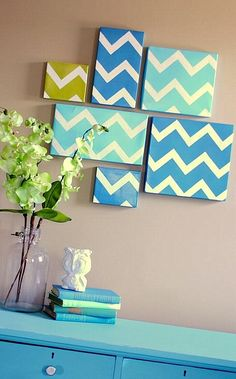 shoe box tops with paint. The project utilizes a downloadable chevron pattern and a variety of box lids sizes. The best part: the edging on the lids makes them easy to hang on the walls with the help of pushpins or nails!